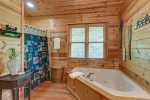 Upper Level Master Suite Features a King Size Bed, Access to Private Deck