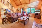 Living Room Features a Wood Burning Fireplace, Flat Screen Tv With Dish Network, and Access to Screened Covered Deck