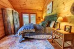 Upper Level Master Suite Features a King Size Bed & Access to Private Screened In Deck