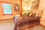 Main Level Master Bedroom Features a King Size Bed & Access to Screened in Deck
