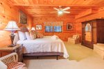 Basement Level Master Suite Features a King Size Bed