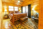 Upper Level Master Suite Features a King Size Bed, and Access to Private Deck