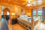 Master Bedroom Features a King Size Bed, Private Deck, and Flat Screen TV