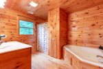 Master Bathroom Features a Jetted Tub & Stand Up Shower