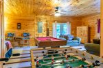 Game Area Features Pool Table, Fooseball Table & Twin Bed