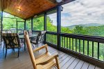 Screened Deck off Living Room Features 2 Rocking Chairs & Outdoor Dining for 4