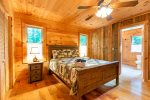 Master Suite Features Queen Bed, Smart TV, & Full Bath