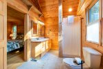 Master Bathroom Features Double Vanity, Stand Up Shower and Jetted Tub