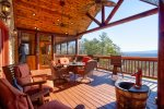 Covered Deck Overlooking Mountains Features Ample Seating and Gas Grill