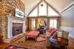 Living Room Features Gas Fireplace, 55 4K Smart TV, Ample Seating and Access to Large Back Porch