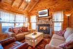 Living Room Features Ample Seating, Gas Fireplace, Flat Screen TV