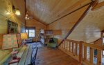 Loft Area Features Twin Bunk Beds, Gas Fireplace, and Desk
