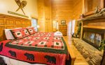 Master Suite Features a King Bed, Wood Fireplace, Access to Screened Dec