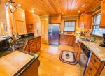 Fully Equipped Kitchen Features Stainless Steel Appliances and Granite Counters