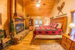 Master Suite Features a King Bed, Wood Fireplace, Access to Screened Deck