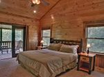 Upper Level 1 Master Suite Features King Bed and Private Deck