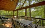 Covered Deck Features Outdoor Dining Table