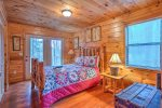 Main Level Bedroom Features a Queen Size Bed, and Access to Covered Deck