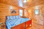 Upper Level Master Suite Features a King Size Bed, Access to Private Covered Deck, and Full Bath