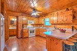 Fully Equipped Kitchen Features Gas Stove and Ample Counter Space