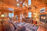 Living Room Features Flat Screen TV, Gas Fireplace and Access to Cover Deck