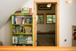 Loft area with kids books and toys