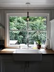 Beautiful farmhouse sink with a window overlooking the deck and back garden