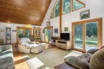 Open living with soaring ceilings and surrounding sliders