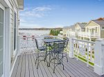 Balcony off the master bedroom offers harbor views
