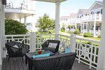 Deck off the living room has relaxing outdoor furniture
