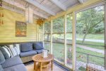 Relax on the porch of Sunshine Cottage as you watch the world go by