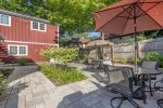 Shared patio space with hot tub, outdoor furniture, and grill