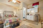 Main level studio suite with a queen bed, kitchenette, bathroom, and more
