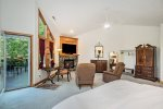Master bathroom ensuite with two sinks, walk in shower, and separate toilet closet
