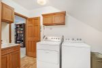 Lower level recreation room with movie screen, fooseball, pool, and more