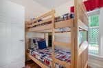Main level bunk room with a twin bunk bed