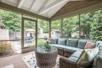 Magical screen porch overlooking the backyard space