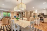 Formal dining space is open to the adjacent kitchen and living