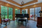 Sun room with piano