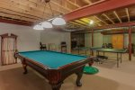 Lower level recreation room with a pool table and more