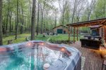 Private backyard at The Whole Shebang with hot tub and deck