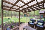 Great outdoor space with a covered deck overlooking the backyard