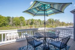 Dock Holiday: Relax on the multi-level decking overlooking the water from this beautiful condo with association pool