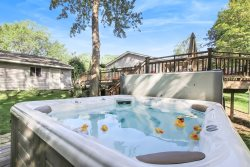 Tuck's Treasure: Spacious home with an incredible deck, patio, hot tub, and fire pit a short walk to Lake Michigan beach
