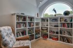 Upper level book nook with an assortment of books to enjoy during your stay