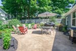 Patio with BBQ grill, outdoor table, and relaxing chairs