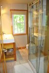 Upstairs full bathroom with a walk in shower