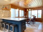 Kitchen overlooks the dining room and out to Lake Michigan