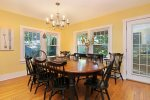 Formal dining is open to the living room and adjacent to the kitchen