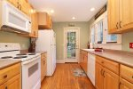 Galley style kitchen with everything you need for quick meal at home